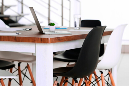 Clean office space with black and white chairs