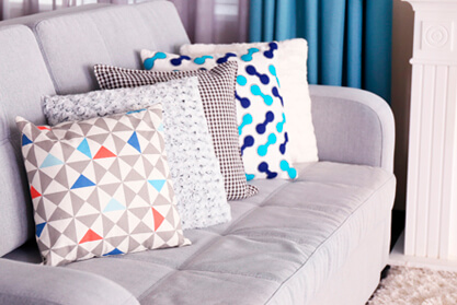 Blue and White Cushions on a Sofa