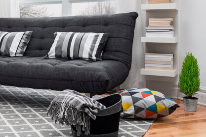 Black sofa bed in a student apartment